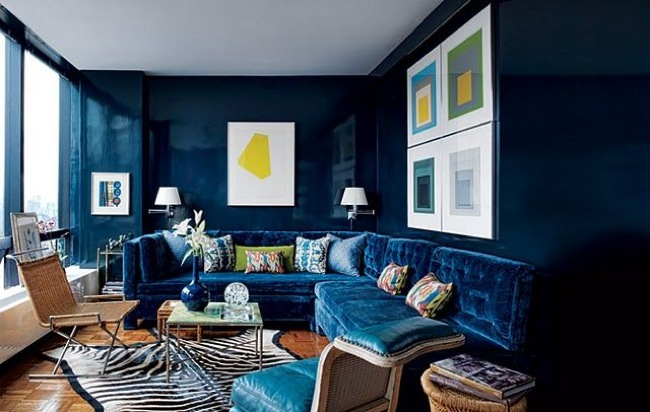 navy walls and sofa