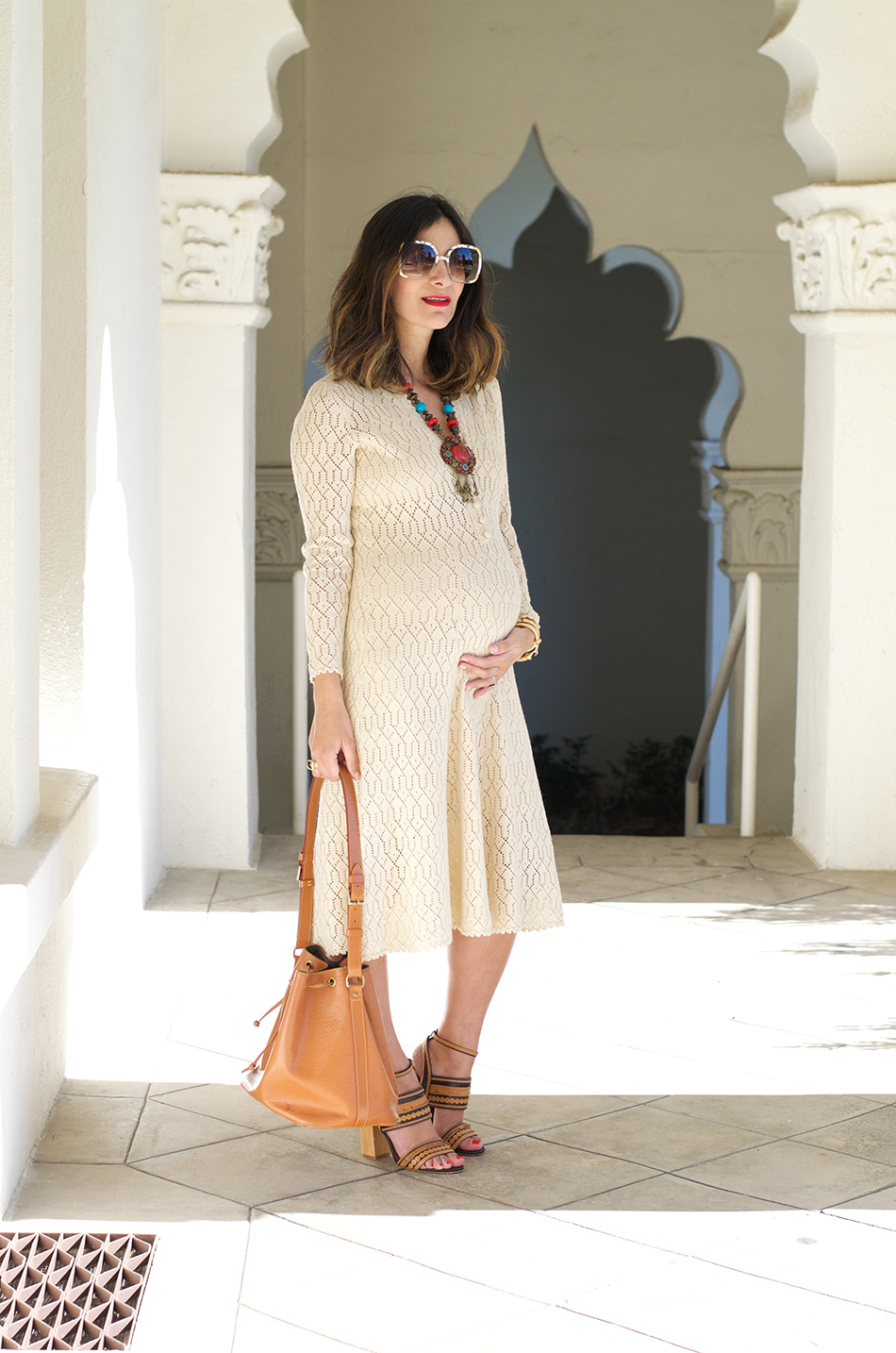 How to wear vintage when pregnant opt for a knit dress in a shorter or midi length which you can wear throughout the entire pregnancy ombrellifo Choice Image