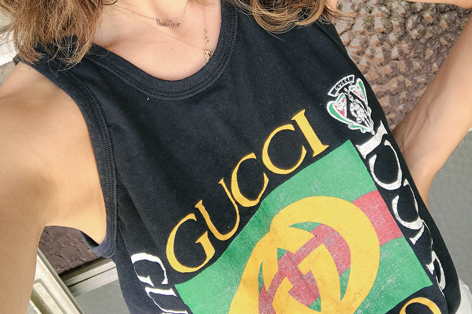 a vintage splendor wearing a vintage gucci tee