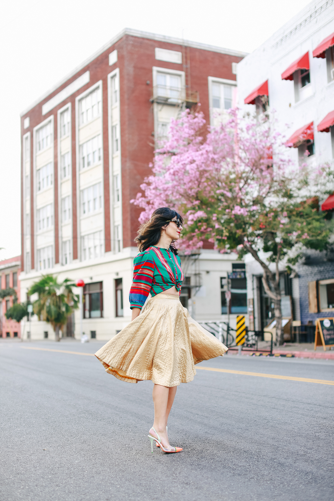 twirl in a gold skirt